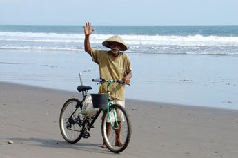 Old man on the beach in West Bali