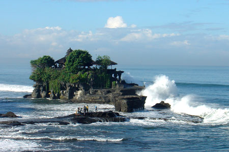 Tanah Lot sea temple lapped by waves